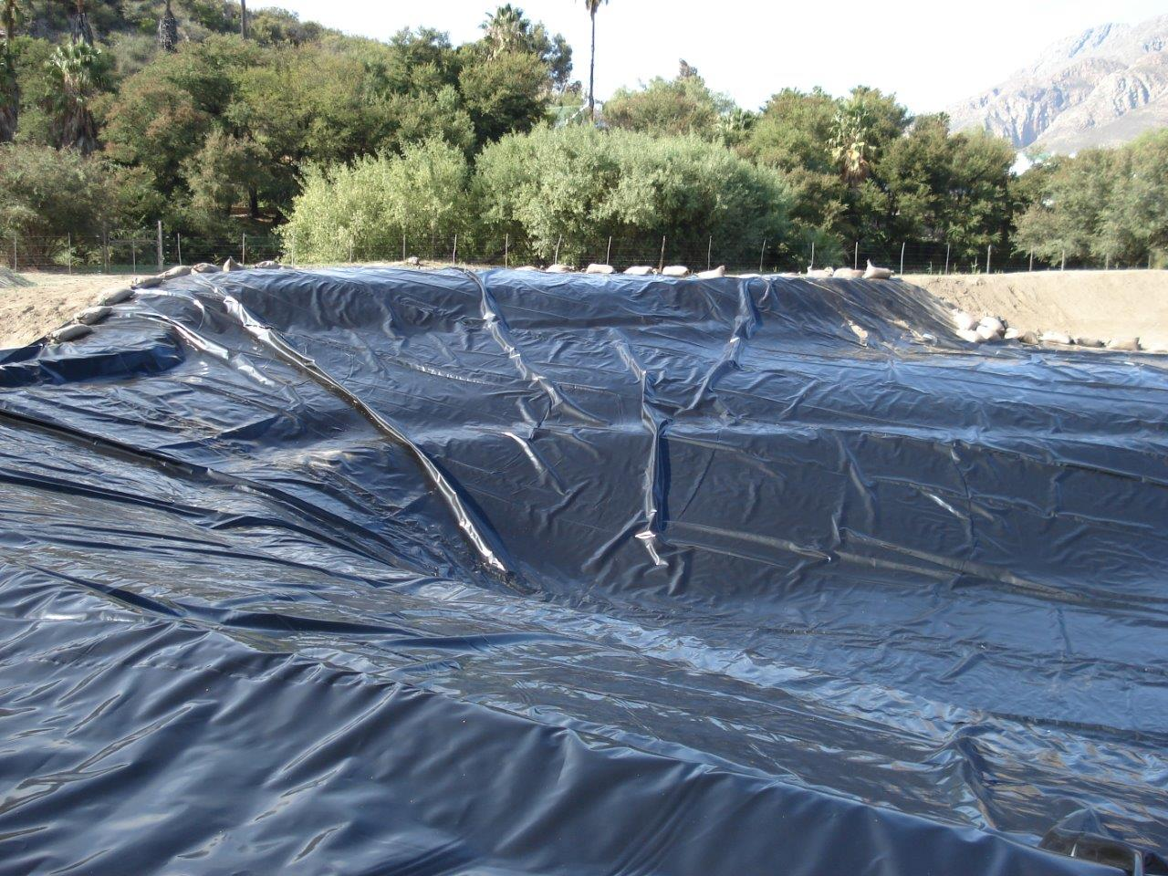 Dam liner installation - Power Plastics