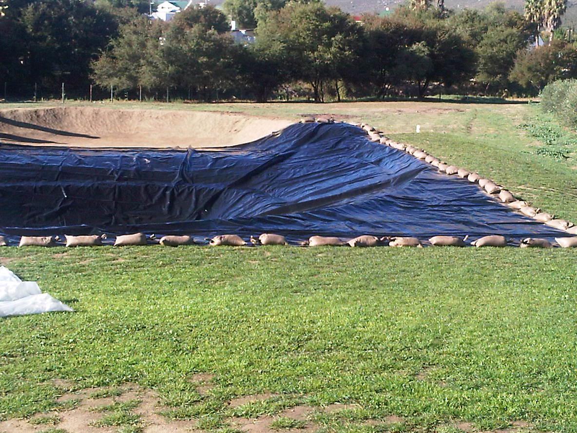 Dam liner installation - Power Plastics