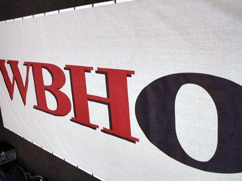 Barrier Netting - WBHO Banner on White Mesh